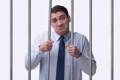 Молодой бизнесмен за барами в тюрьме Стоковое Изображение