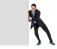 Молодой бизнесмен нажимая пустую доску Стоковое фото RF