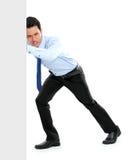 Молодой бизнесмен нажимая пустую доску Стоковая Фотография RF
