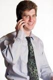 Молодой бизнесмен на сотовом телефоне стоковая фотография
