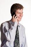 Молодой бизнесмен на сотовом телефоне стоковые фотографии rf