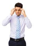 Молодой бизнесмен страдая от головной боли стоковая фотография