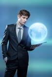 Молодой бизнесмен с компьютером экрана касания Стоковые Изображения RF