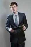 Молодой бизнесмен с компьютером экрана касания Стоковое Изображение RF