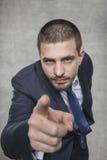 Молодой бизнесмен указывая на вас стоковая фотография rf