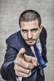 Молодой бизнесмен указывая на вас стоковое фото rf