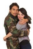 Молодой воинский солдат возвращает для того чтобы встретить его жену Стоковая Фотография