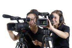 2 молодой женщины с видеокамерами стоковая фотография rf