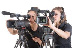 2 молодой женщины с видеокамерами стоковые фото