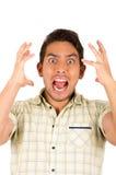 Молодой красивый испанский человек выражая удар Стоковое Фото