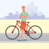 Молодой красный битник волос с велосипедом Стоковая Фотография