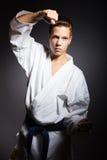 Молодой мальчик в кимоно спорт в judoka изображения Стоковое Изображение RF
