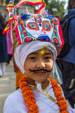 Молодой мальчик в фестивале GaijatraThe коров Стоковое Изображение