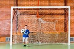 Молодой мальчик играя хранителя цели Стоковая Фотография RF