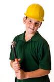 Молодой мальчик - будущий рабочий-строитель Стоковая Фотография RF