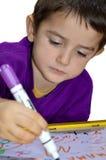 Молодой мальчик пишет Стоковая Фотография RF