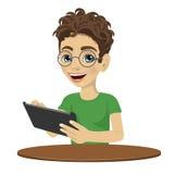 Молодой мальчик подростка болвана используя планшет иллюстрация штока