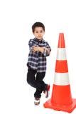 Молодой мальчик с сигналом дороги конуса Стоковая Фотография