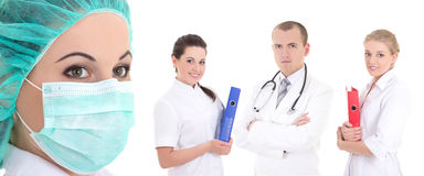 Молодой медицинский персонал стоя на белой предпосылке Стоковые Изображения RF