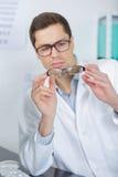 Молодой мужской доктор работая в офисе Стоковое Изображение