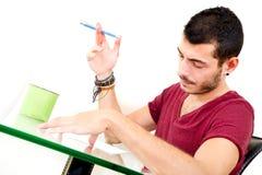 Молодой мужской думать в офисе Стоковые Изображения