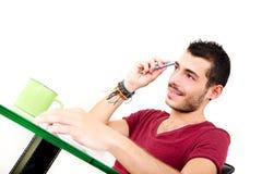 Молодой мужской думать в офисе Стоковая Фотография RF