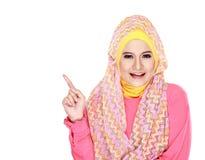 Молодой мусульманский указывать женщины Стоковая Фотография