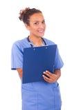 Молодой доктор при стетоскоп изолированный на белой предпосылке стоковая фотография rf