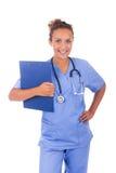Молодой доктор при стетоскоп изолированный на белой предпосылке стоковое фото rf
