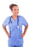 Молодой доктор при стетоскоп изолированный на белой предпосылке стоковое изображение rf
