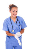Молодой доктор с стетоскопом при перчатки изолированные на задней части белизны Стоковые Изображения