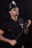 Молодой полицейский в студии Стоковые Изображения RF