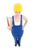 Молодой привлекательный построитель женщины в workwear при изолированный молоток Стоковые Фото