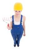 Молодой привлекательный построитель женщины в workwear с paintbrus ролика Стоковое Фото