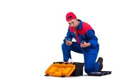 Молодой ремонтник при гаечный ключ ключа изолированный на белизне Стоковая Фотография RF