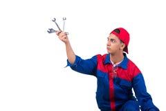 Молодой ремонтник при гаечный ключ ключа изолированный на белизне Стоковое фото RF