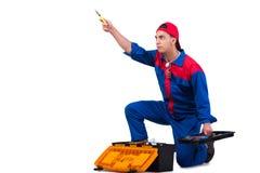 Молодой ремонтник при гаечный ключ ключа изолированный на белизне Стоковые Изображения