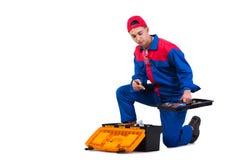Молодой ремонтник при гаечный ключ ключа изолированный на белизне Стоковые Фото