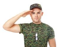 Молодой салютовать солдата армии Стоковые Изображения