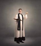 Молодой священник в давать его благословение Стоковое Фото