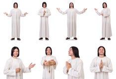 Молодой священник при библия изолированная на белизне Стоковая Фотография RF