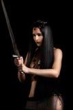 Молодой сексуальный ратник женщины с шпагой Стоковая Фотография
