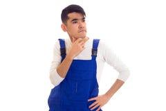 Молодой сердитый человек в голубой прозодежде Стоковое Фото