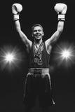 Молодой спортсмен боксера на черной предпосылке Стоковые Фотографии RF