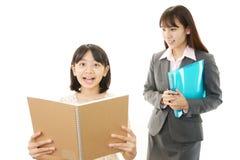 Молодой студент изучая с учителем Стоковые Фото
