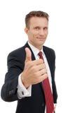 Молодой счастливый бизнесмен показывая большой палец руки вверх по знаку Стоковые Изображения