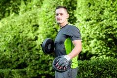 Молодой тренер спортсмена Стоковые Изображения