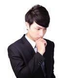 Молодой думать бизнесмена стоковое фото
