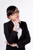 Молодой думать бизнес-леди Стоковые Фото