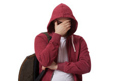 Молодой унылый подросток изолированный на белой предпосылке Стоковое Изображение RF